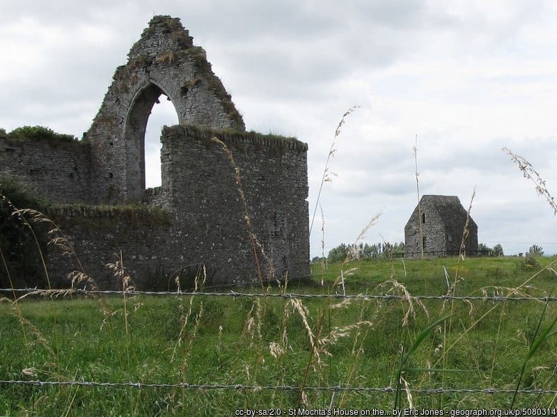Old ruined stone abbey with a stone building on the side