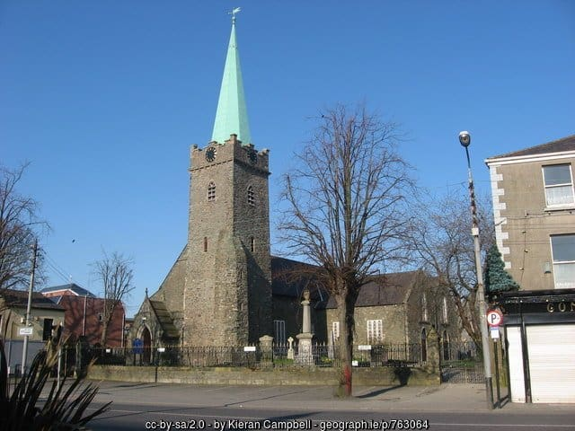 An old medieval church with a green copper spire
