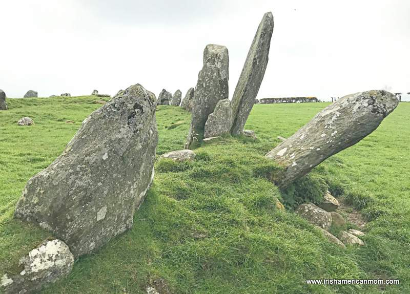 Section of a stone circle with some of the standing stones at a tilt