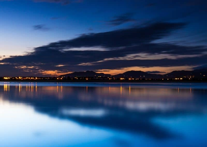 A body of water at night