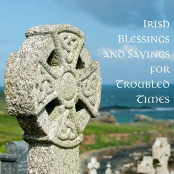 The top of a stone Celtic Cross beside the shoreline