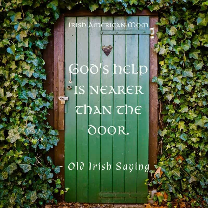 A green door surrounded by ivy walls illustrating the Irish saying God's help is nearer than the door