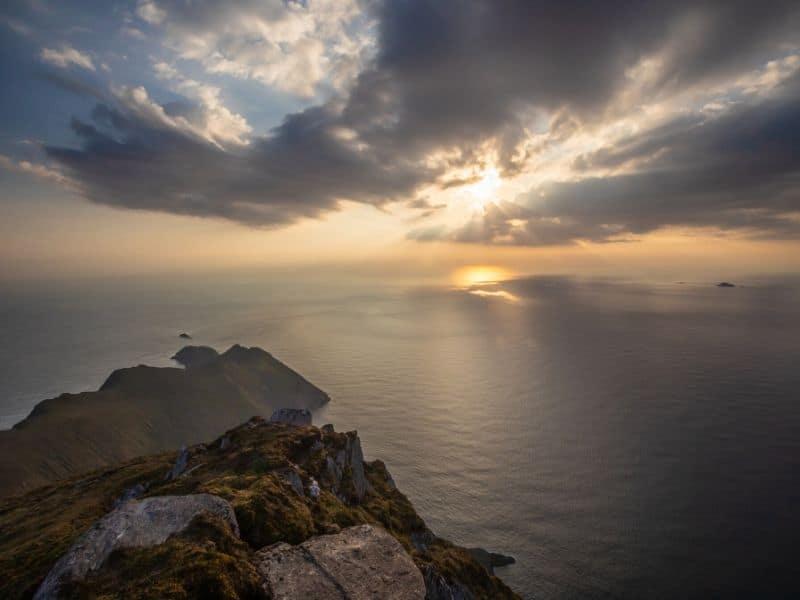 Sun setting over sea cliffs on the Atlantic Ocean