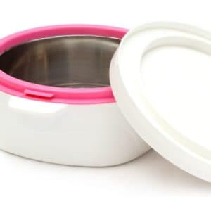 A white cake storage tin with a pink rim