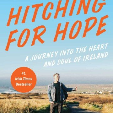 Book cover for Hitching for Hope featuring a man on an Irish rural road with his thumb out hitching for a ride