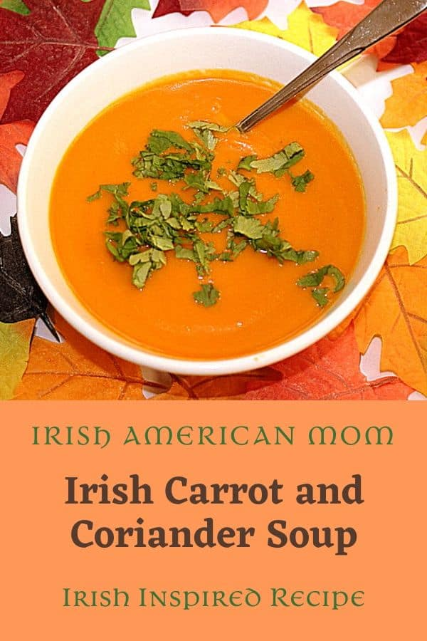 A white bowl of orange carrot and coriander soup with a cilantro garnish in an orange graphic for Irish American Mom recipes