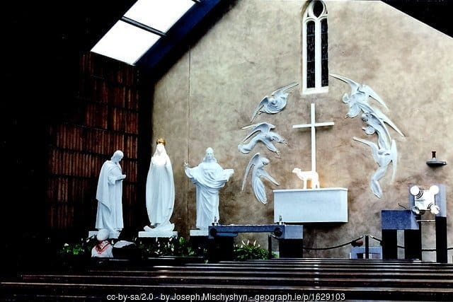 Gable end of the church in Knock with white states and an altar as a shrine to the Virgin Mary