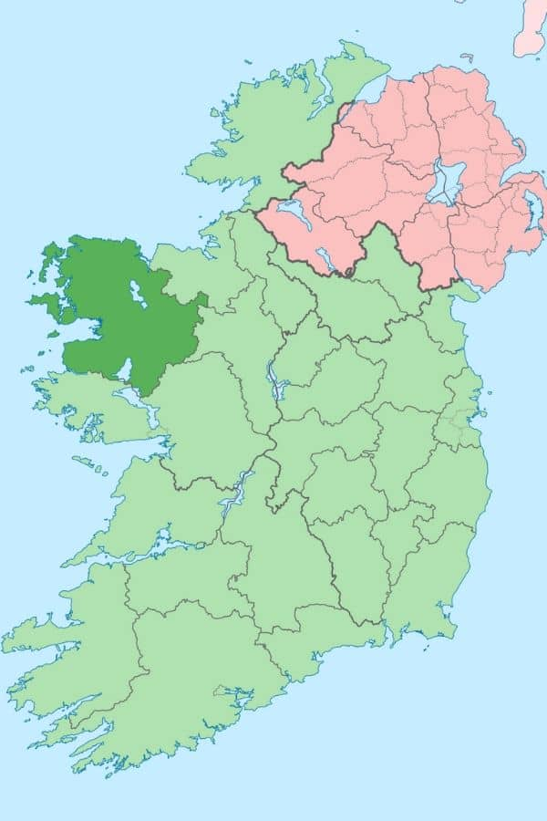 A green county map of Ireland showing County Mayo in the west in dark green and Northern Ireland in red