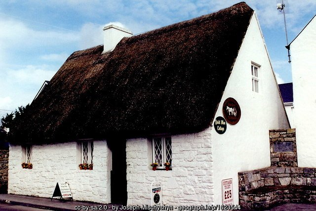 A thatched cottage with white walls in Cong County Mayo is home to the Quiet man museum