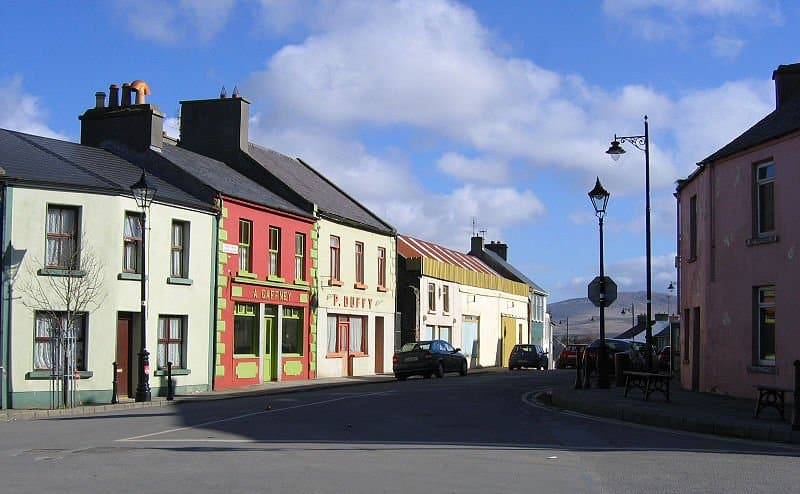 Colorful shop fronts and buildings on a street in an Irish village