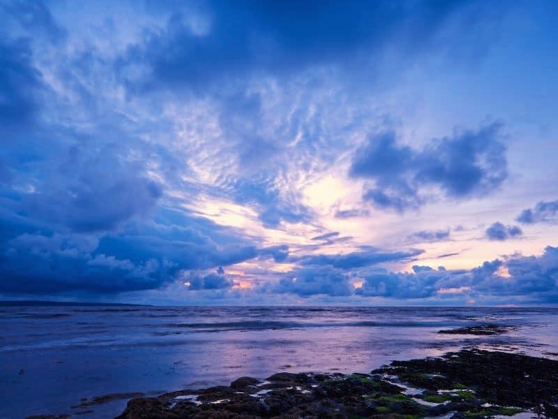 Blue, purple and orange shades illuminate the skies over the Atlantic ocean in Ireland