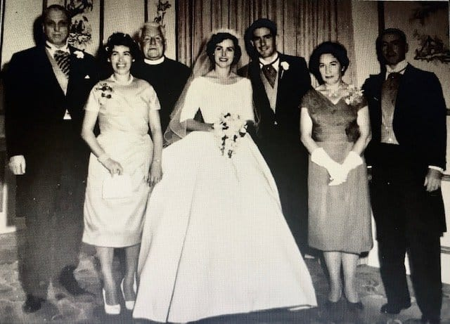 A black and white family wedding portrait