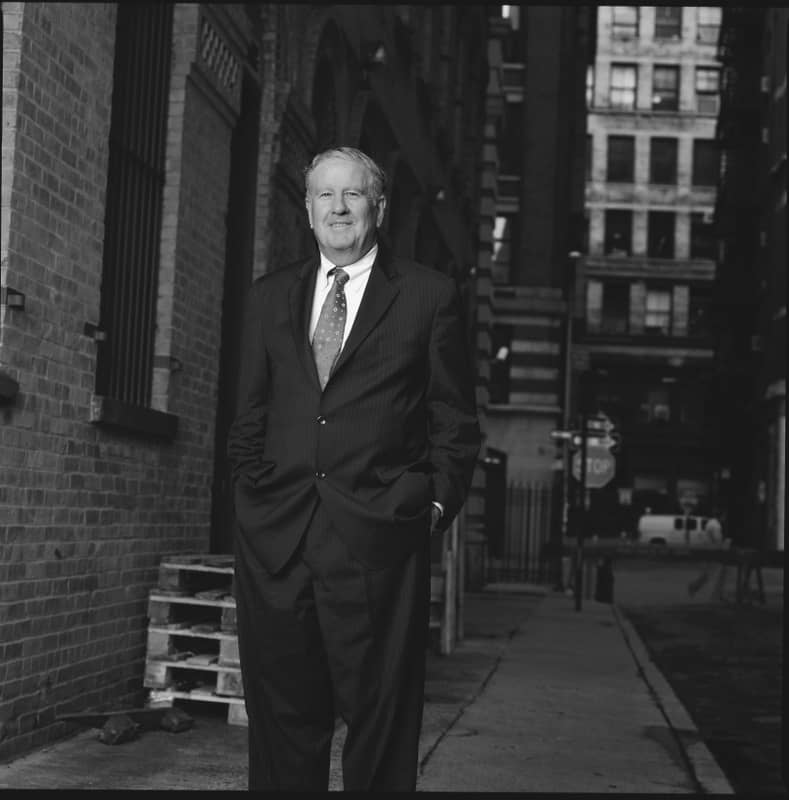 Black and white photo of a man in a suit in New York City