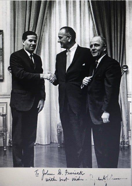 Black and white photo of President Lyndon Johnson with two men