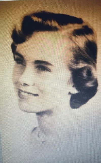 Black and white headshot of a young woman in the 1960's