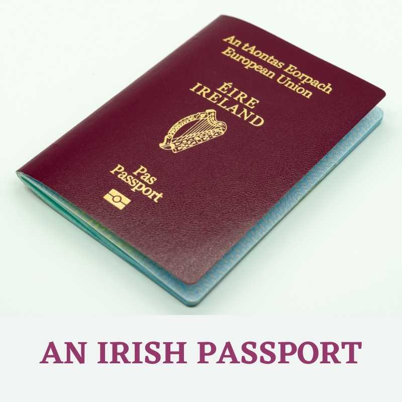 A maroon colored Irish passport with gold writing featuring a harp as a symbol of Ireland and a symbol of a harp