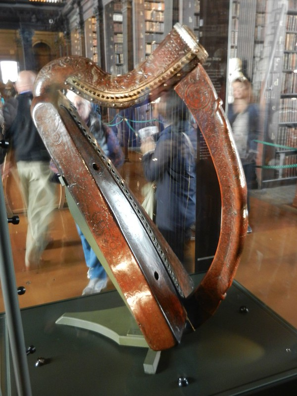 A brown wooden harp on display