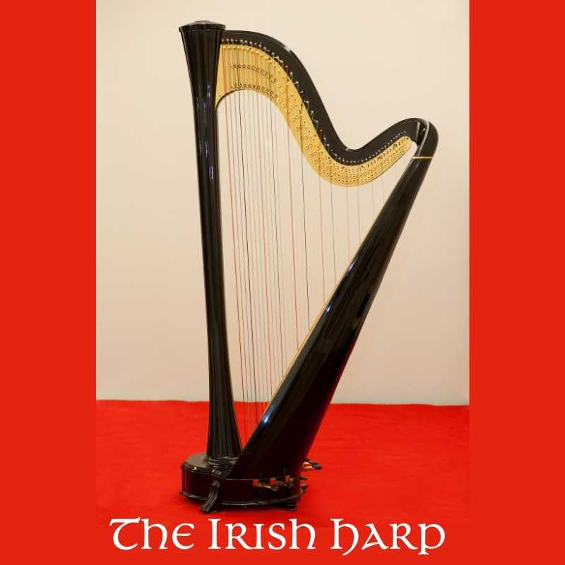 An Irish harp musical instrument displayed against cream and red backgrounds