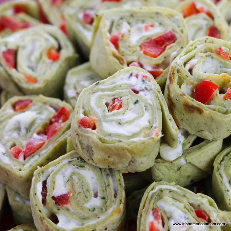 Red bell pepper diced with cream cheese spread inside tortilla roll up sandwiches