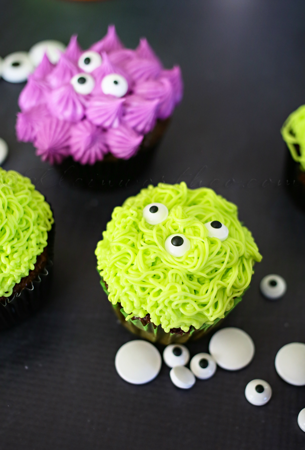 Green and purple monster cupcakes with eyes for Halloween
