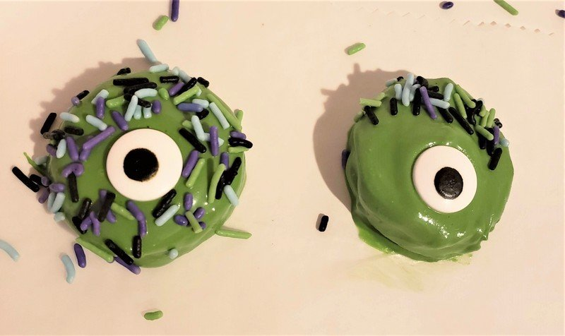 Colorful sprinkles on green monster cookies with one candy eye