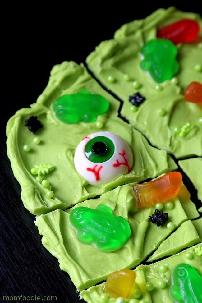 Green chocolate bark treat for Halloween with eyeballs and gummy ghosts