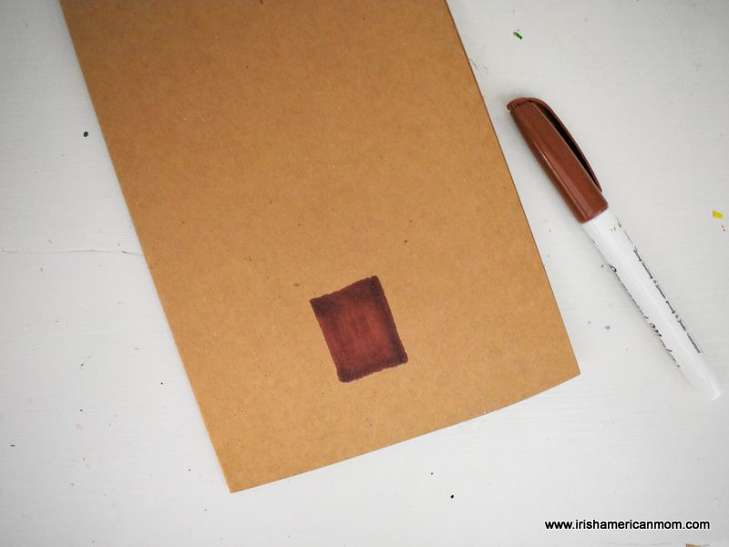 A folded sheet of brown card stock with a brown marker rectangle to mark a tree trunk