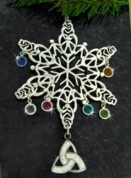 Silver snowflake ornament with birthstone charms and a Trinity Knot charm