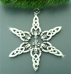 Silver star ornament with Celtic knot rays and adjoined Claddagh designs at the base of each ray