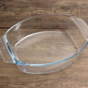 A glass casserole dish on a wooden counter