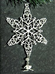Silver snowflake or star shaped Christmas ornament with an Irish dancer charm hanging from the bottom spoke