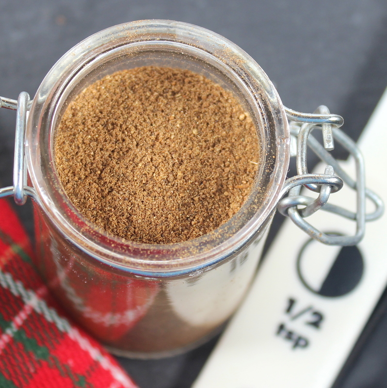 Aerial view of a small mason jar of brown mixed spice for baking