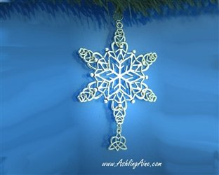 A silver snowflake ornament with a Celtic knot sisters pendant displayed against a blue background
