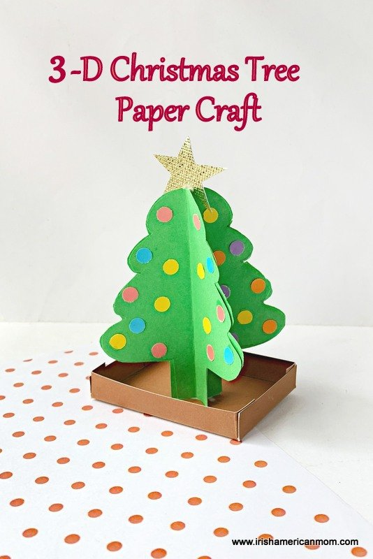 A paper Christmas tree in three dimensions on a polka dot surface