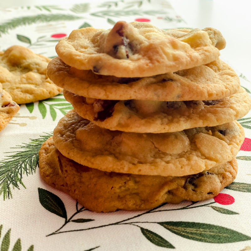 Five cookies in a stack on a green white and red cloth