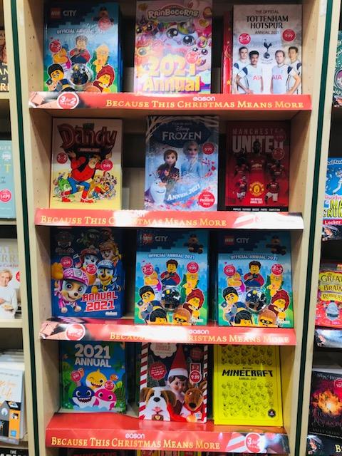 Illustrated books on a shelf