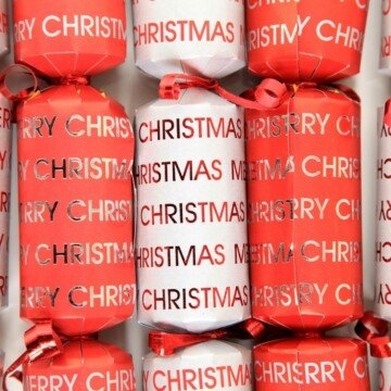 Red and white Christmas crackers with text