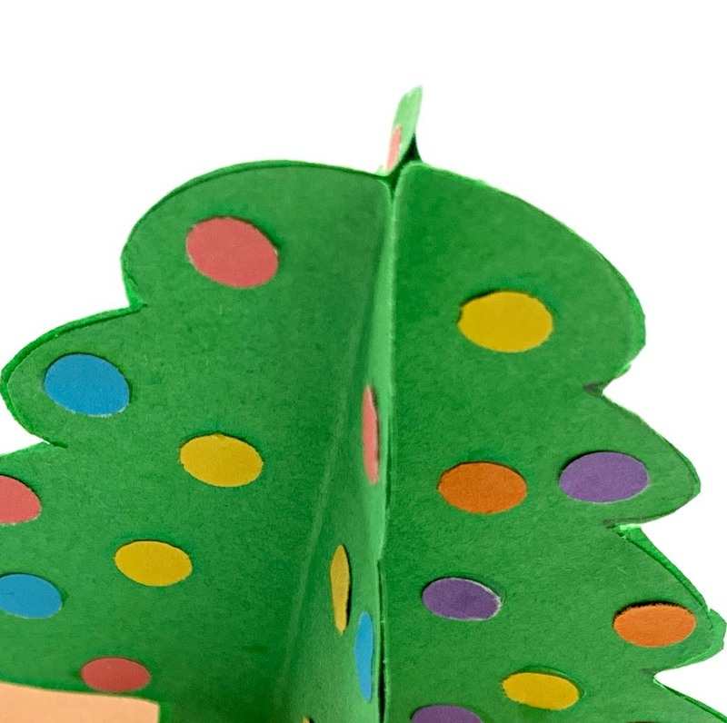 Looking down on a paper Christmas tree made from 4 paper trees glued together to form one tree