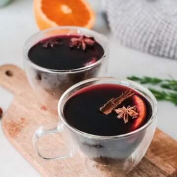 Red mulled with with cinnamon and star anise in glass cups on a cutting board