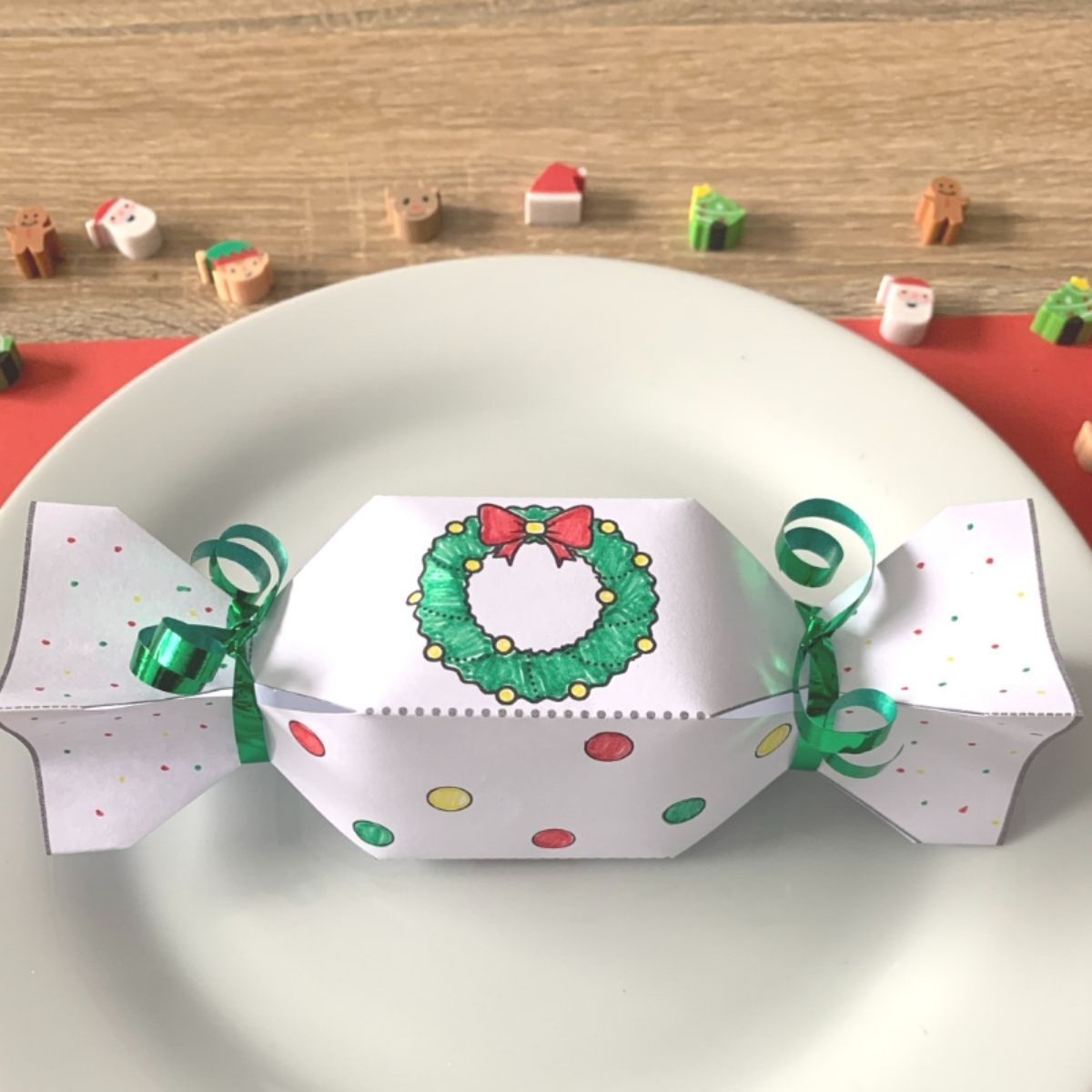 Paper Christmas cracker on a white plate
