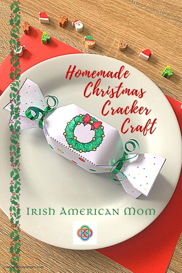 A white plate with a homemade Christmas cracker on a graphic with red text and a holly border
