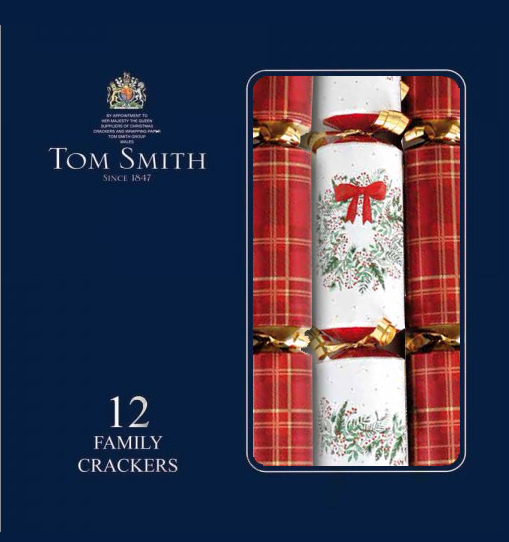 Tartan crackers beside a white cracker with holly and a red bow in a navy box with text