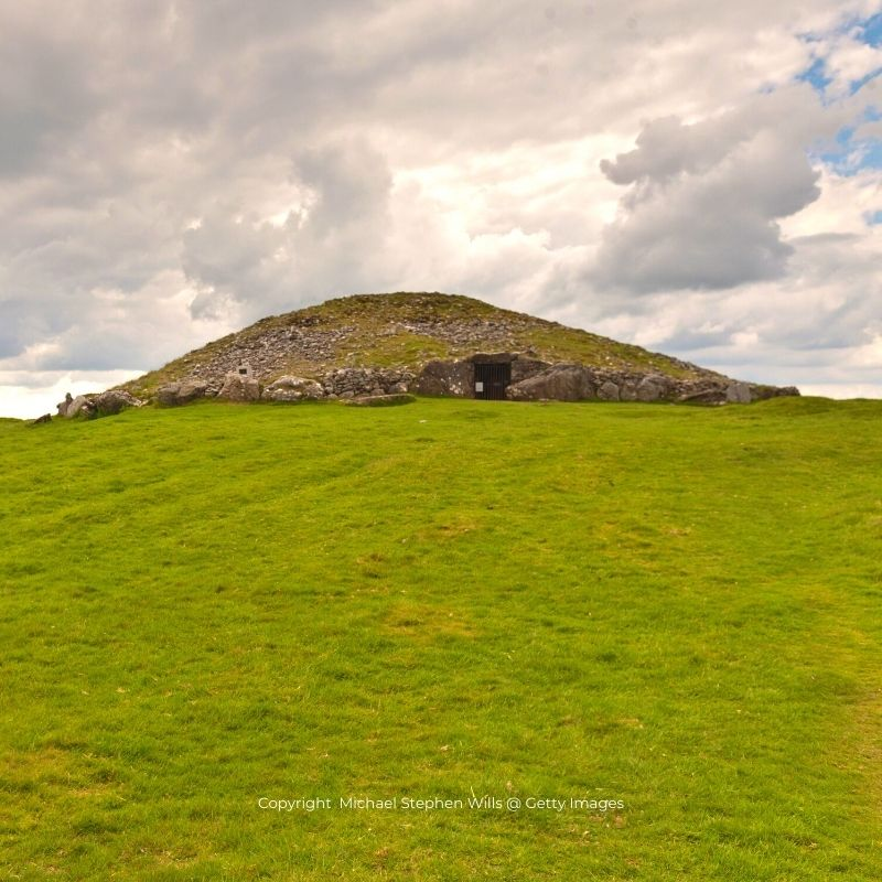 A stone burial mound on top of a hill