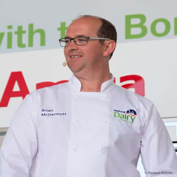 A man in a white chef's jacket