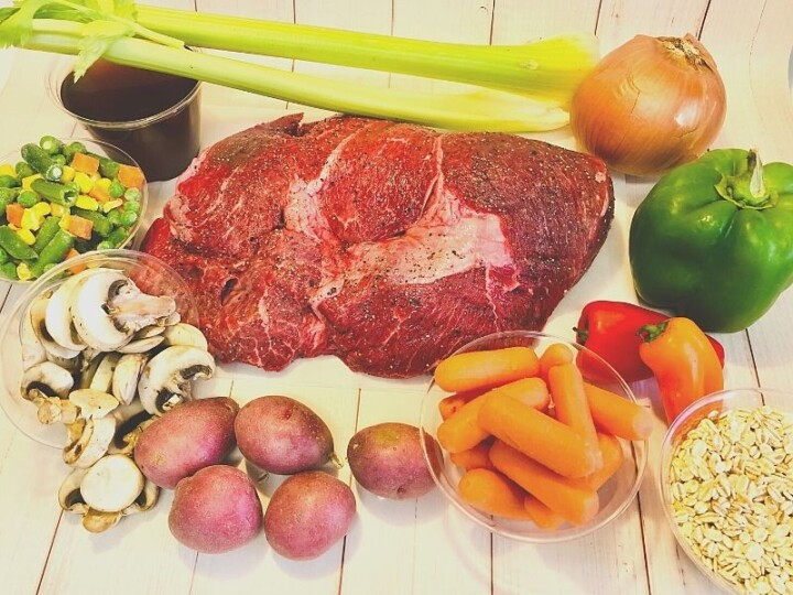 Beef join surrounded by vegetables
