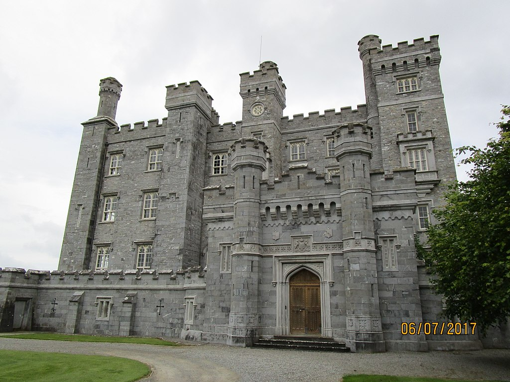 S large stone castle with turrets and a wooden door