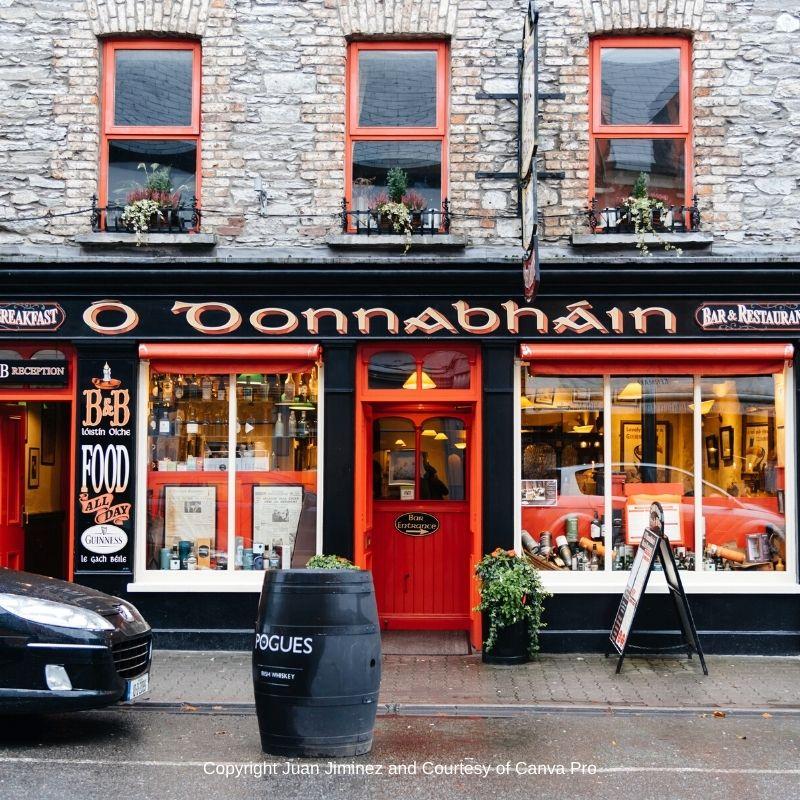 Irish pub with red door and three upper level red windows