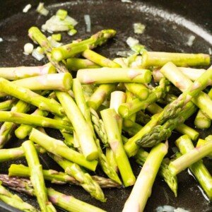 Asparagus and green onion in a skillet