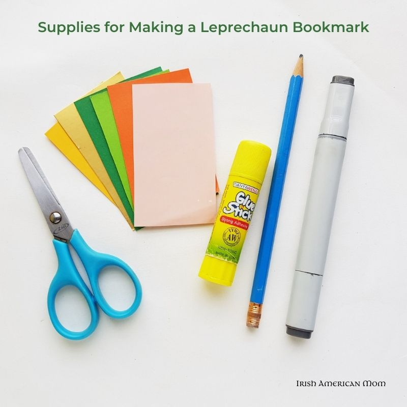 Supplies for a paper craft including card paper, scissors, glue stick, pencil and sharpie marker