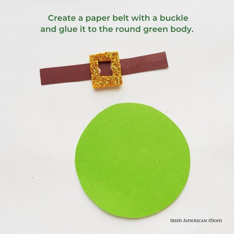 Paper belt with gold buckle beside a green paper circle and with text overlay